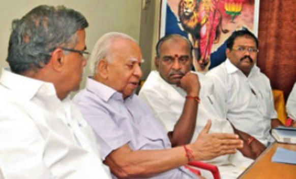 TNA leader R. Sambanthan interacts with BJP leaders L. Ganesan and state president Pon Radhakrishnan during his visit to Chennai on Tuesday to seek support for empowerment of Lankan Tamils. - DC