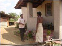 Selvarajah Kajendren talking to a neighbour of Jeyakumari at Tharumapuram, Ki'linochchi