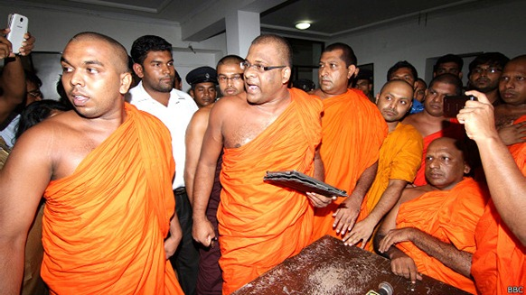 Wataraka Vijitha Thero (seated right) has seen press conferences disrupted
