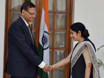 Sri Lankan Foreign Minister G L Peiris with his Indian counterpart Sushma Swaraj in New Delhi on Friday. PTI
