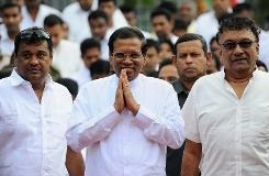 Sri Lankan President Maithripala Sirisena arrives to address the nation from outside the Buddhist Temple of Tooth in the central town of Kandy on January 11, 2015